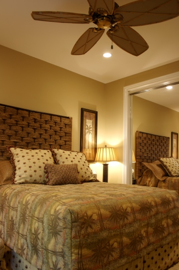 Bedroom with ceiling fan and recessed lighting